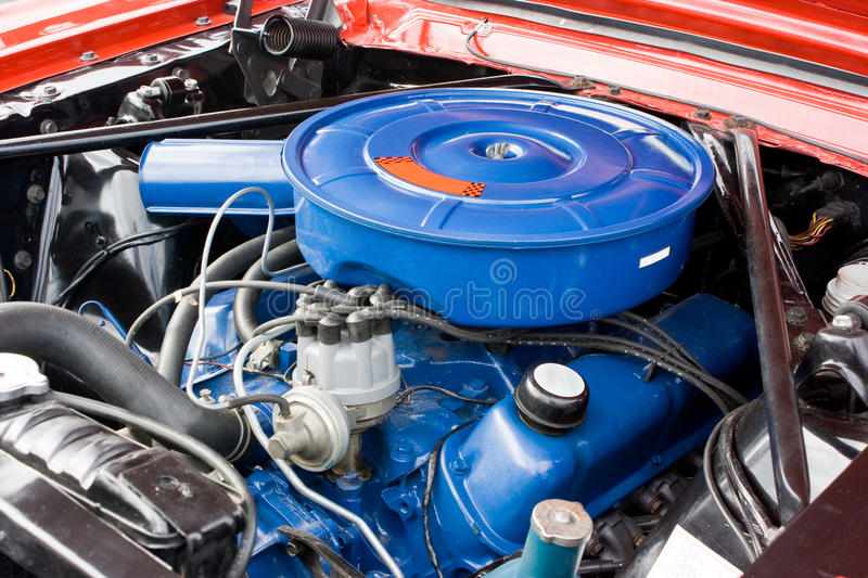 1966 Ford Mustang 8 Cylinder Engine. 1966 Ford Mustang eight cylinder engine, painted blue with blue air cleaner assembly. Factory original 289 motor stock photo