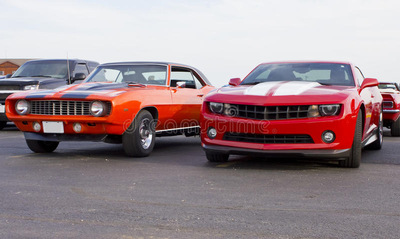 1969 & 2013 Red Chevolet Camaros stock photography