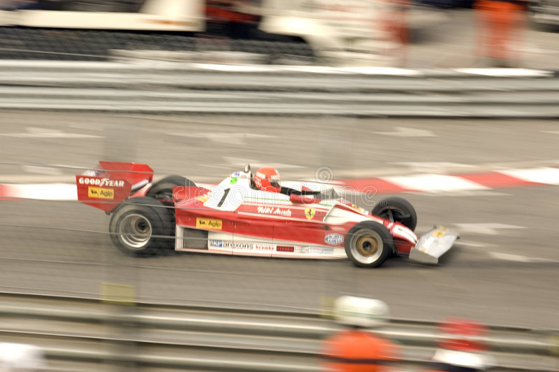1976 Ferrari 312 T2. Driven by Chris MacAllister approaching the swimming pool complex at the 2004 Monaco Historic Grand Prix stock image