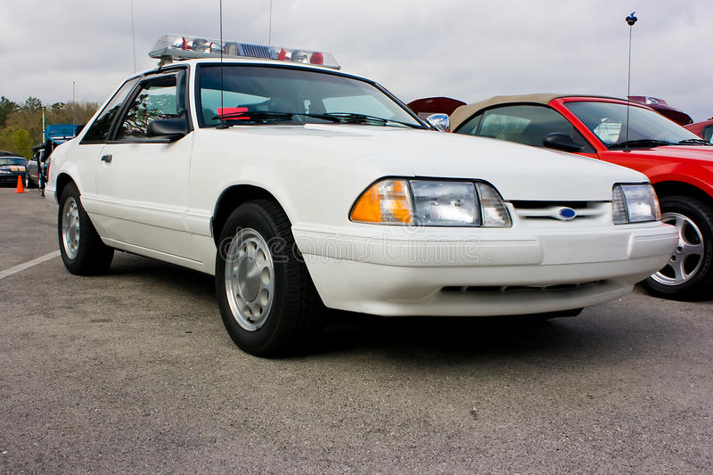 1993 Ford Mustang Police Car. 1987-1993 Ford Mustang police car, white. This automobile was used by the highway patrol for its speed and handling. Plain car with royalty free stock images