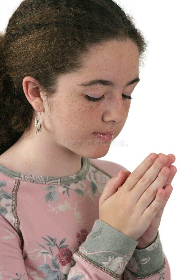 2个女孩祈祷青少年 免版税图库摄影