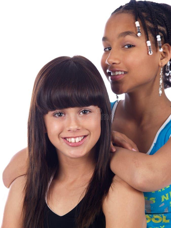 2个逗人喜爱女孩摆在 免版税库存图片