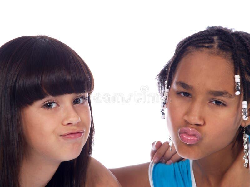 2个逗人喜爱的女孩 库存照片