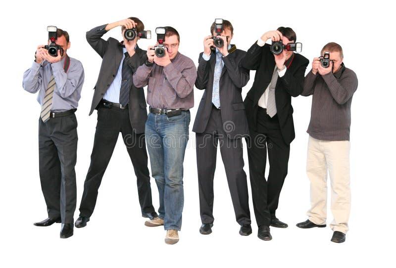 2位查出的无固定职业的摄影师 免版税库存图片
