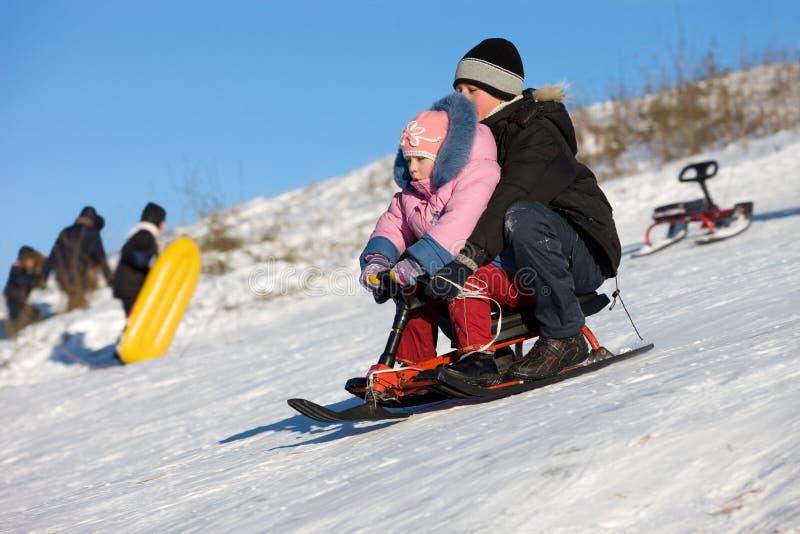 2张乐趣高sledding的速度 库存照片