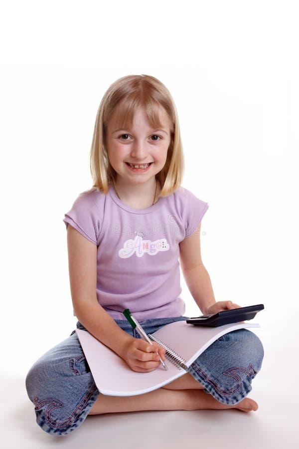 2执行的女孩家庭作业 免版税库存图片