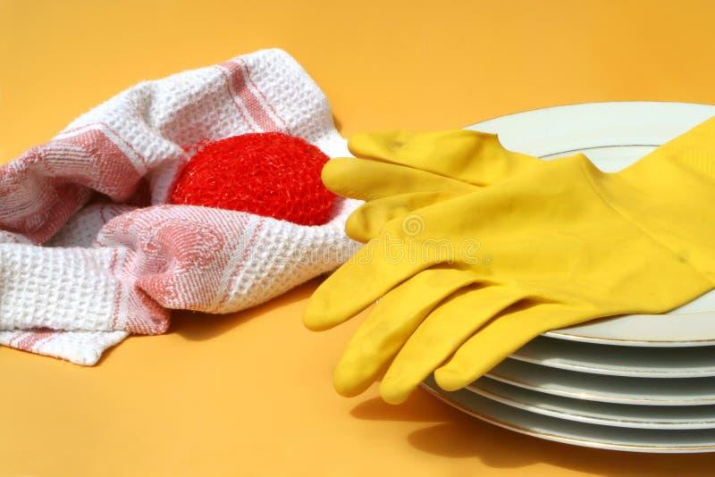 2洗碗盘行为 免版税库存图片