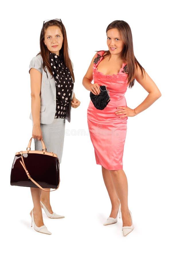 2 таких же женщины нося костюм и платье дела стоковое фото rf
