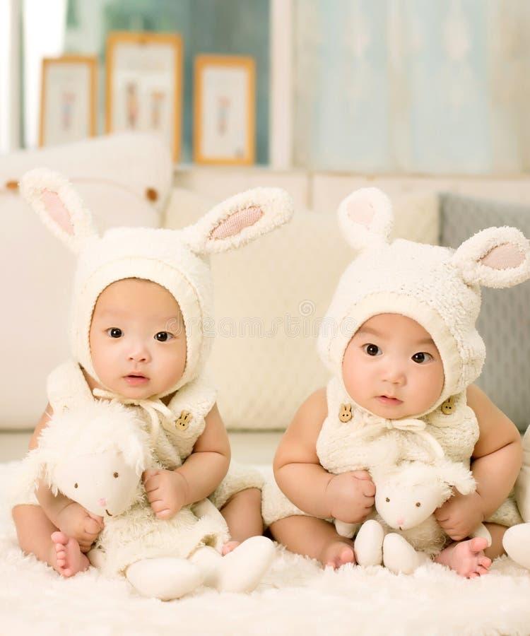 2 Babies Wearing White Headdress White Holding White Plush Toys Free Public Domain Cc0 Image