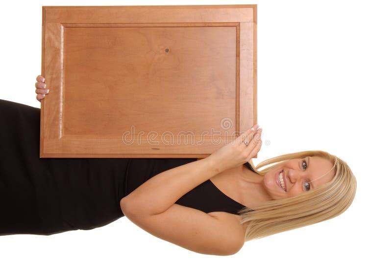 2 blondynką dziewczyna trzyma sexy znaku fotografia royalty free
