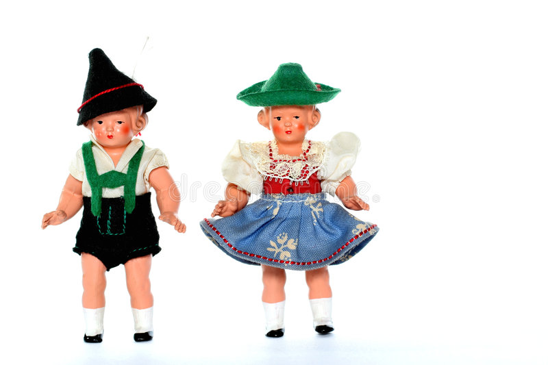 2 Dolls with traditional European dresses. 2 dolls in traditional European (I think they are Austrian but not sure) dresses stock photo
