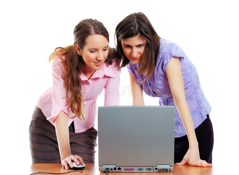 2 elegant women with a laptop stock photography