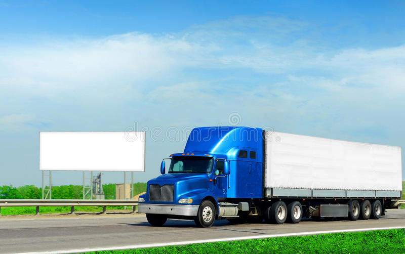 2 industries. Cargo truck and road billboard stock image