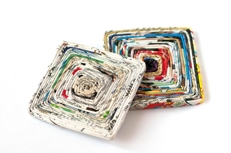 2 paper coasters made of old magazines stock images