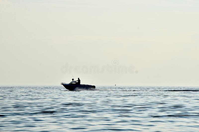 2 People In Boat On Ocean During Daytime Free Public Domain Cc0 Image