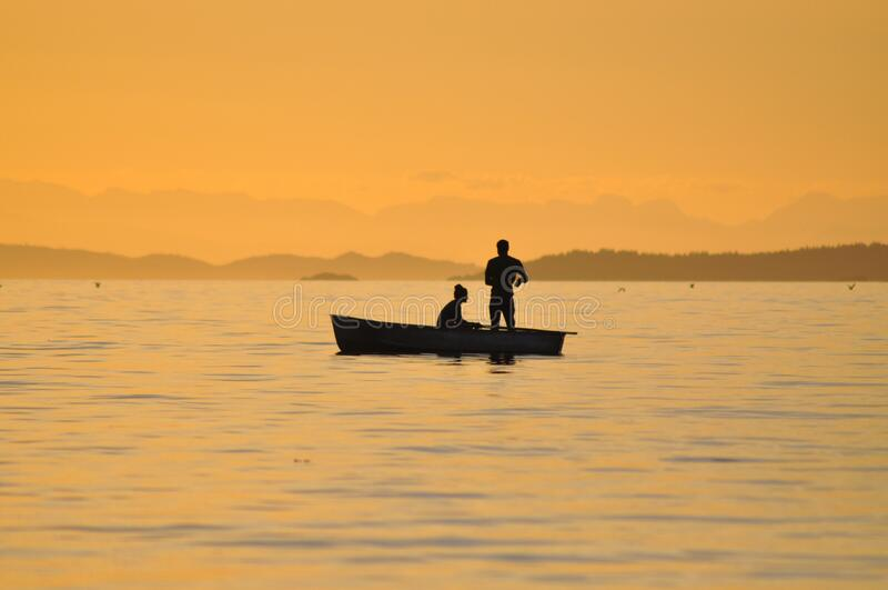 2 People Standing Sitting In A Boat On Body Of Water Free Public Domain Cc0 Image