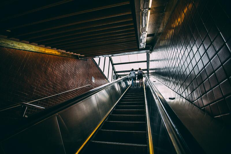 2 Person Standing On Black Escalator During Daytime Free Public Domain Cc0 Image