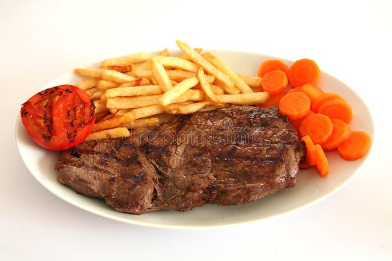2 stek, frytki zdjęcie royalty free