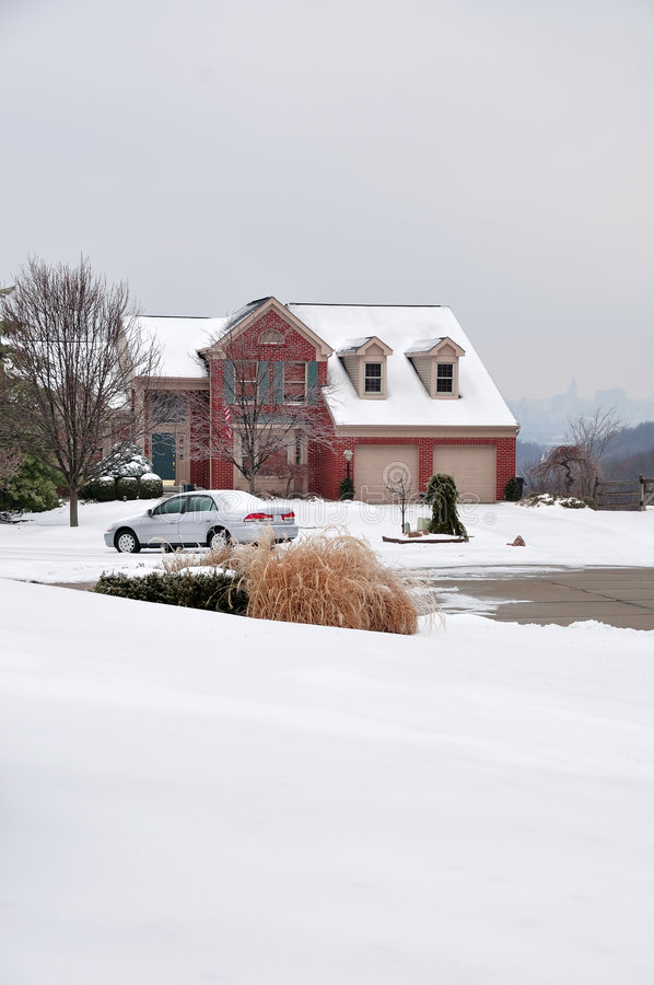 2-story Brick House In Winter. Two-story brick house in winter with snow on the ground stock images