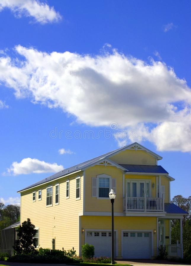 2-story yellow American dream home with garage royalty free stock image