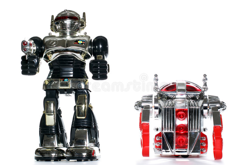 2 toy robot friends. Picture of two toy robots walking down. One of the many thousand toys my brother is collecting. Battery opperated toy from the 80's royalty free stock image
