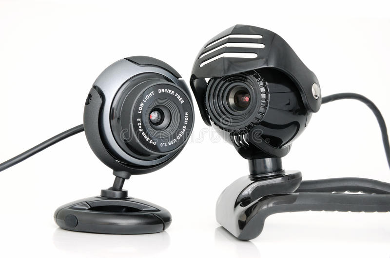 2 Web-cameras. For internet video-conference on white background stock images