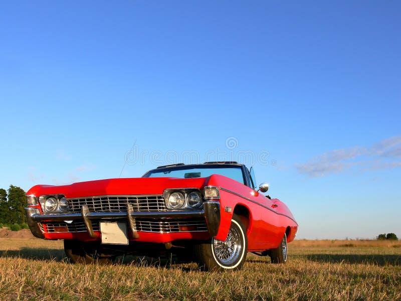 20世纪70年代美国汽车经典敞篷车红色 免版税库存照片