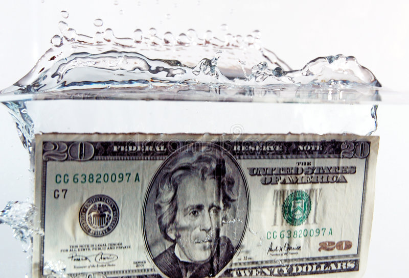 $20 bill splash. $20 dollar bill dropped in water royalty free stock images
