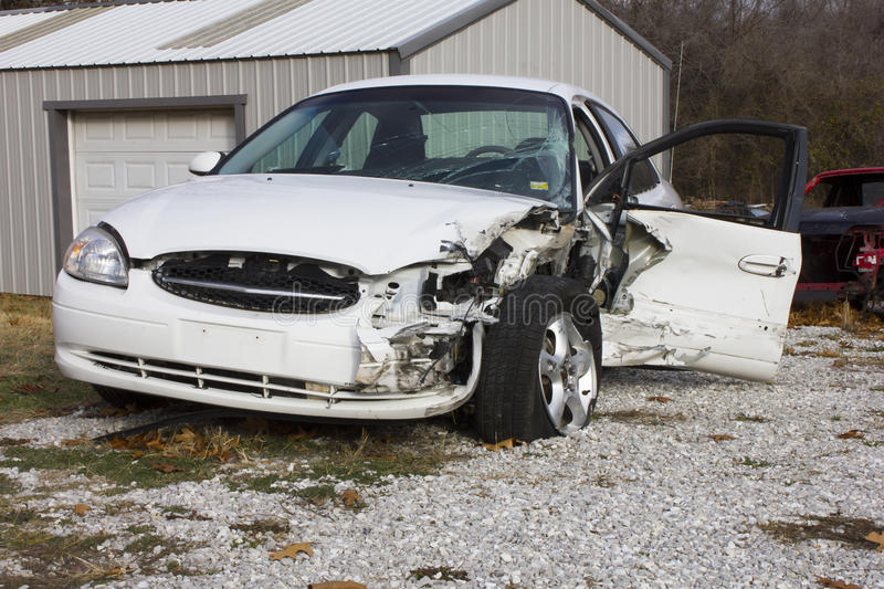 2000 Ford Taurus Wreck. 2000 Ford Taurus with hood, fender, door and front bumper damage. This model of automobile is the same from 2000 to 2007 stock image