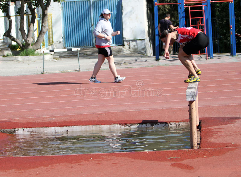 Download 2000 Meter Steeplechase editorial stock photo. Image of barrier - 24854188