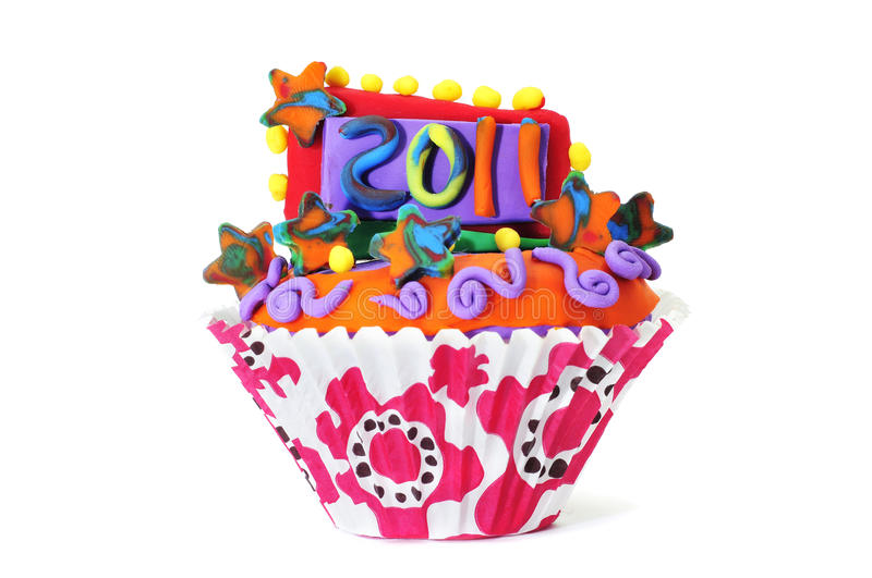 2011 cupcake. A cupcake with the number 2011 on a white background royalty free stock photography