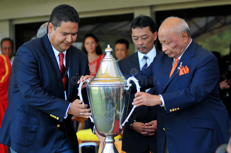 2011 FIP POLO WORLD CUP. 13, June 2011, HRH Sultan Haji Ahmad Shah received the Malaysia Trophy at Royal Pahang Polo Club Pekan,Pahang Malaysia watched by HRH royalty free stock image