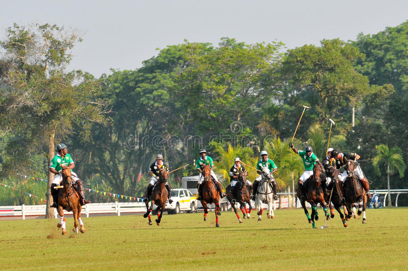 2011 FIP POLO WORLD CUP. 13 June 2011, Nigeria players chasing the ball from the player South Africa at Royal Pahang Polo Club Pekan Pahang, Malaysia stock photography