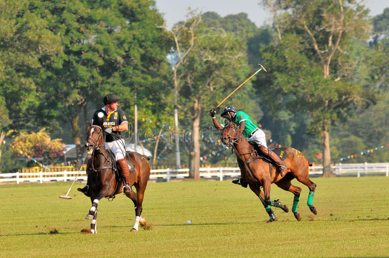 2011 FIP POLO WORLD CUP. 13 June 2011, Nigerian player full swing the ball as seen by Australian player at Royal Pahang Polo Club Pekan Pahang, Malaysia stock images