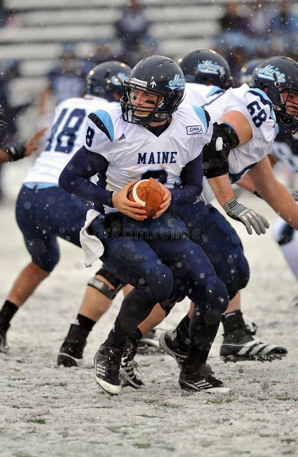 2011 NCAA Football - handoff in the snow stock photo