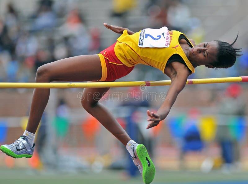 2012个女孩跳高跟踪 库存照片