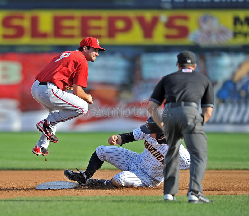 2012 Minor League Baseball - Eastern League. TRENTON, NJ - JULY 29: Harrisburg second baseman Sean Nicol jumps over a sliding baserunner during a double play in stock images
