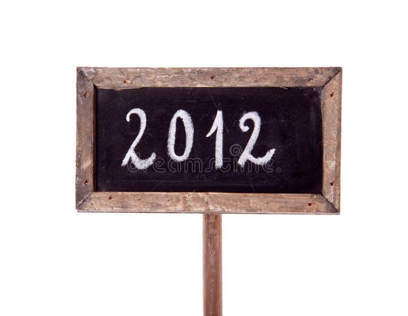 2012 written on a blackboard royalty free stock image