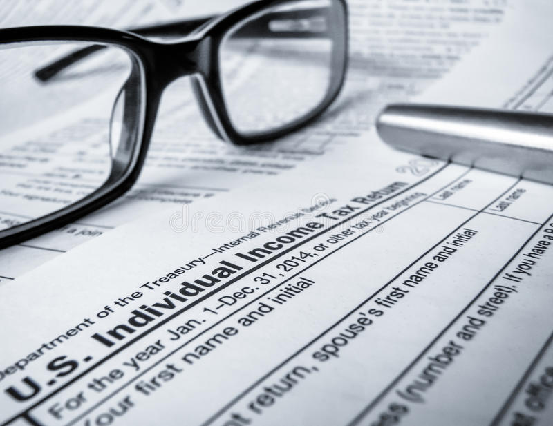2014 Tax Return. Detail Of A 2014 Tax Return With Glasses And Pen (With Shallow DoF royalty free stock image