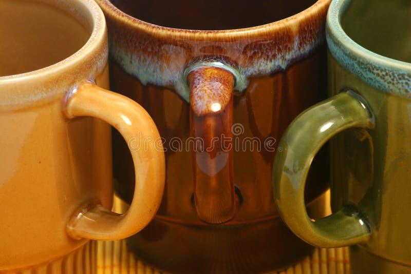 248 kaffekoppar tre arkivfoto