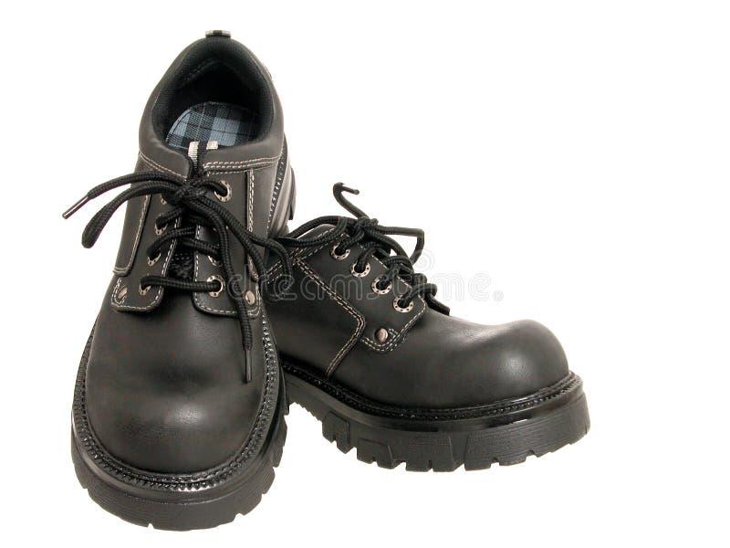 染黑s鞋子冬天妇女 库存照片