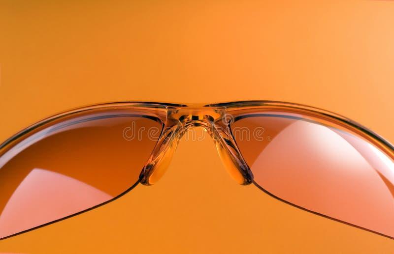 橙色太阳镜 免版税库存照片
