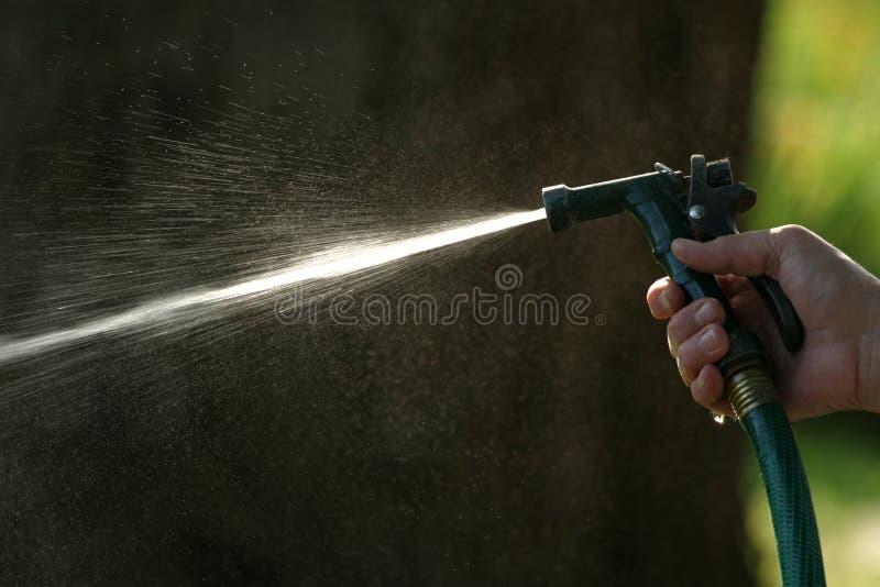 水管喷洒 免版税图库摄影
