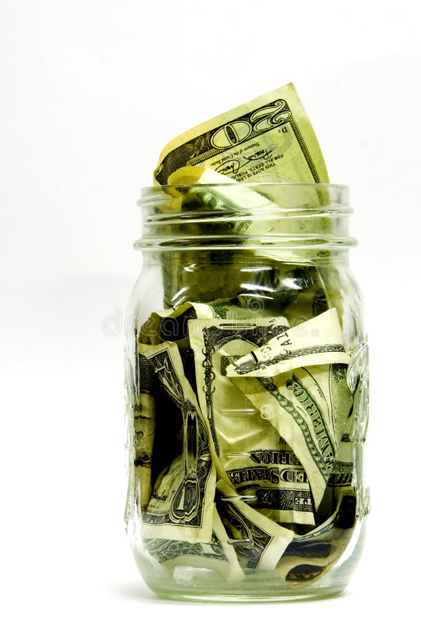 瓶子货币 免版税图库摄影