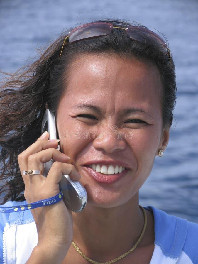 3个亚洲人电话妇女 免版税库存照片