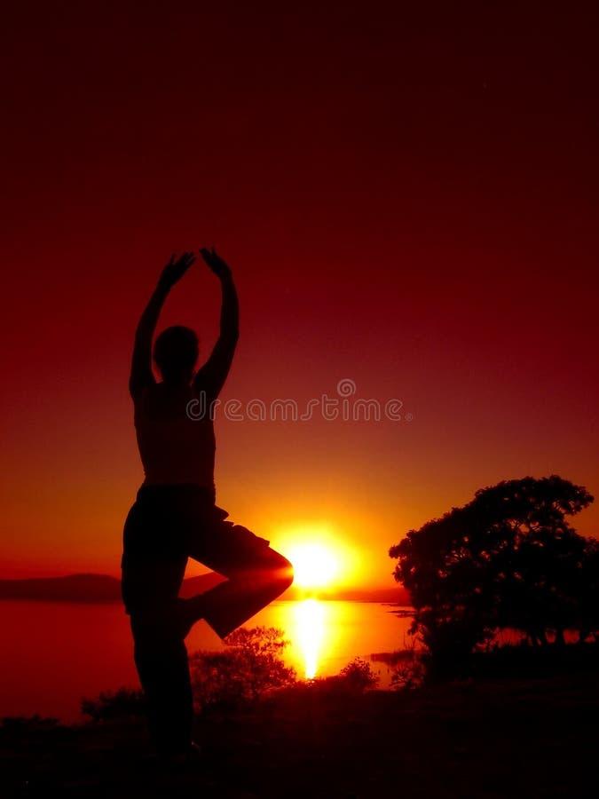 3日落瑜伽 免版税库存图片
