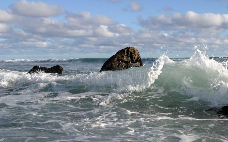 3朵云彩海浪 图库摄影