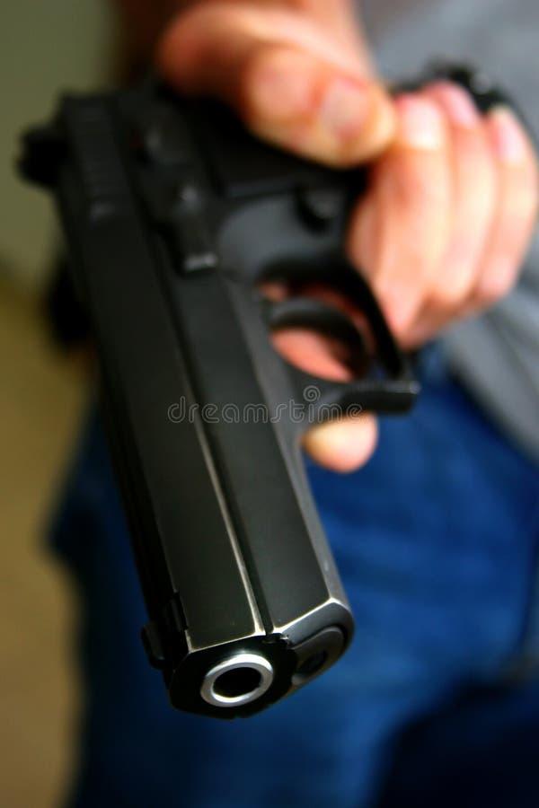 3现有量拿着手枪 免版税图库摄影