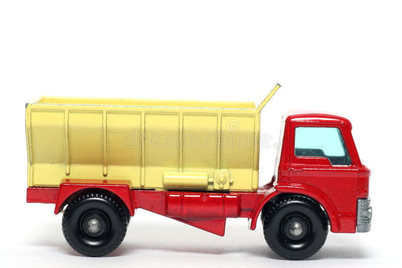 3辆汽车沙粒老分布的玩具卡车 库存照片