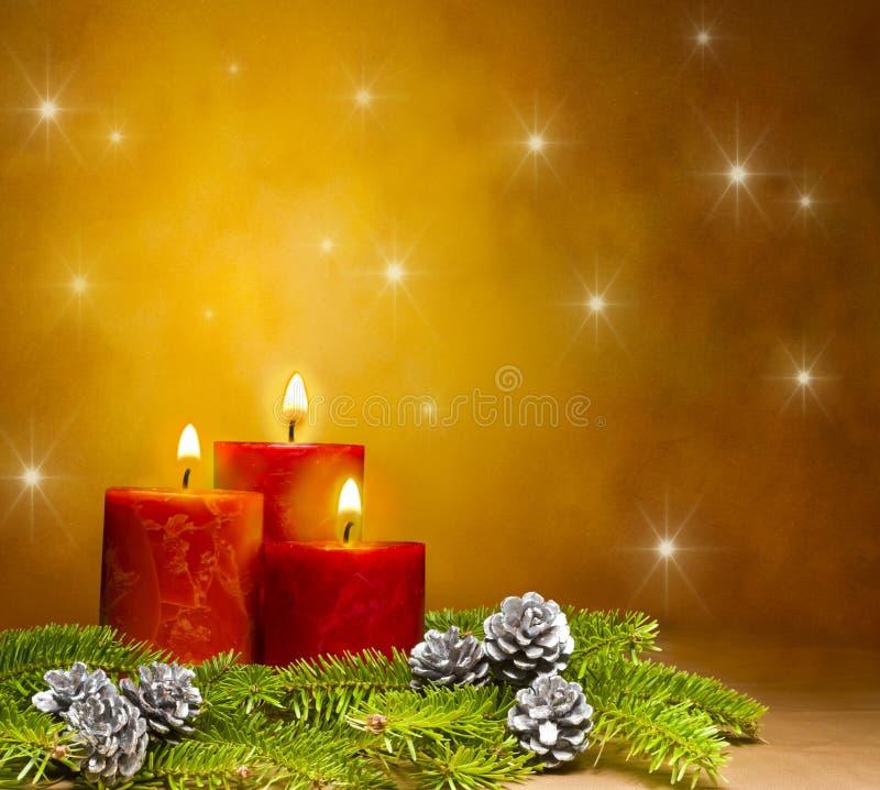 3 свечки в праздничной установке рождества стоковые изображения
